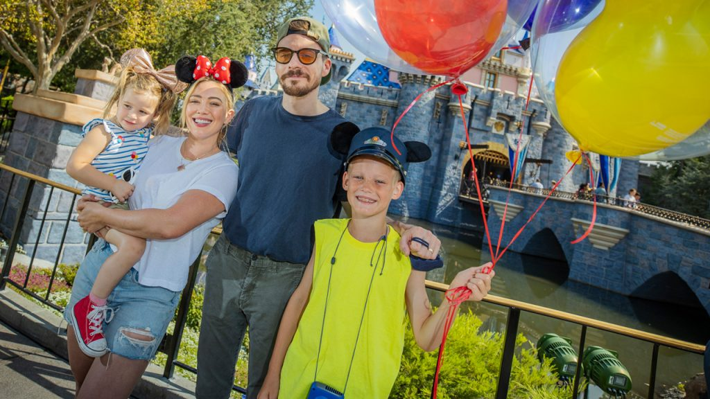 Hilary Duff, her husband, singer-songwriter Matthew Koma, their daughter Banks, 2, and Duff's son Luca, 9, posed for a photo on the steps of Sleeping Beauty Castle at Disneyland park